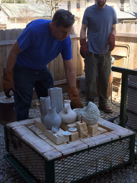 Brett loads the kiln with bisqued and glazed pieces. The lid of the kiln is put on and the pieces are heated to 1850 degrees.